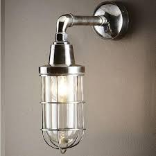 caged lighting. industrial caged wall light lighting n