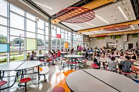 elementary school cafeteria. The New Cafetorium Transforms From A Lunchroom Into Performance Space Large Enough To Fit One Grade. It Features Acoustical Baffles, Sound System, Elementary School Cafeteria