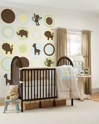 simple cream rug with nursery braid basket under crib plus animal wall decal also brown window boy high baby nursery decor