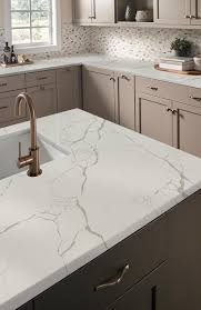 Tis the season for visitors, and nothing welcomes friends and family quite  like a kitchen adorned in new Q TM Premium Natural Quartz countertops.