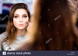 madrid spain 27th january 2018 a model is makeup after the show of miguel marinero during mercedes benz fashion week madrid fall winter 2018 at ifema on
