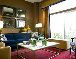 Triad-The red rug, the blue sofa, and yellow drapes and vases make a  triadic color scheme. These contrasting colors create an appealing look in  the living ...