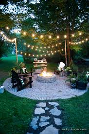 outside house lighting ideas. Cozy Outdoor Fire Pit And String Lights Outside House Lighting Ideas