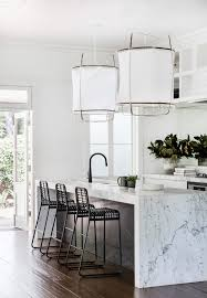 earthy furniture. Marble Waterfall Kitchen Counter And Big Fabric Pendants | Earthy Modern House Tour On Coco Kelley Furniture U
