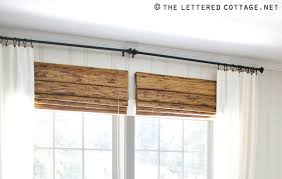add A Bamboo Shade That Is Hung Closer To The Curtain Rod Than The ...