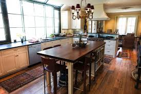 reclaimed antique salvaged white oak flooring and walnut counter top for a kitchen island in a