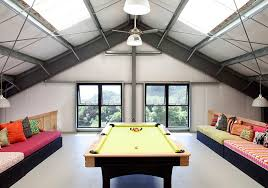 View in gallery Restrained use of color in the stylish attic game room