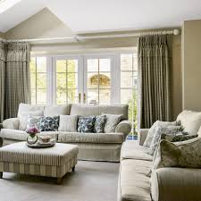 Ideal Home Living Room Dual Aspect Living Room With Linen Sofas And Showcase Curtains