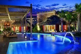 outdoor pool lighting design. gorgeous swimmming pool with curved shape outdoor lighting design