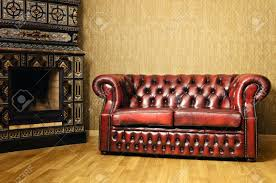Old Sofa Old Red Genuine Leather Sofa Near The Fireplace Stock Photo