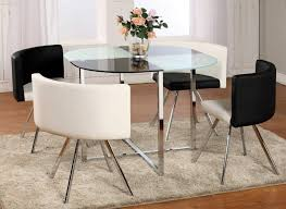 majestic round dining table sets with pillar crystal chandelier in neutral color with large window and plain curtain