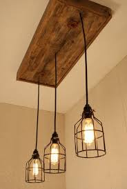 reclaimed industrial lighting. cage light chandelier lighting edison bornagainwoodworks interiordesign reclaimed industrial i
