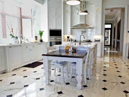 elegant transitional kitchen with black and white marble flooring