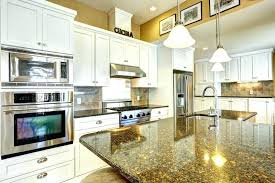 white kitchens with granite countertops kitchen cabinet cabinets yellow counters off s