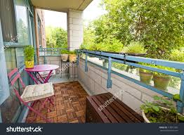 balcony of condo with patio furniture and plants preview save to a lightbox balcony condo patio furniture