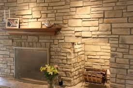 faux stone siding and stone veneer fireplace with fireplace mantle also firewood storage and home lighting