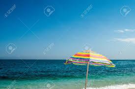 Image Carry Bag Rainbow Beach Umbrella Isolated On Sea Background Mediterranean Sea Stock Photo 78982681 123rfcom Rainbow Beach Umbrella Isolated On Sea Background Mediterranean