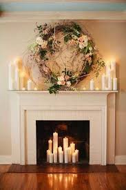 Gorgeous Ceremony Backdrop: Fireplace decorated with romantic candles and a  beautiful wreath. #wedding