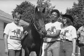 slew of people. mickey taylor, left, and karen owners of seattle slew, stand by slew people