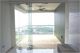 half opened frameless door beautiful balcony city view robust innovative glass system true open concept design