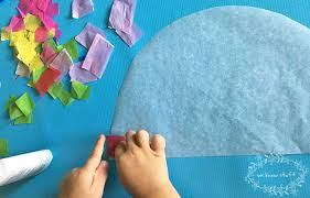 this super fun suncatcher craft with tissue paper makes really cute stained glass rainbows it s