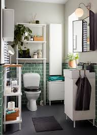 small bathroom cabinet. a small bathroom with green tiles and grey floor white lillÅngen wall cabinet