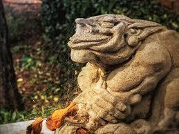 gothic garden gargoyle statue spider webs
