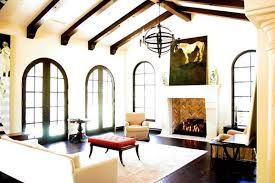 View in gallery A Mediterranean living room with dark-stained ceiling beams