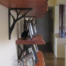 best ideas about kitchen crashers live edge wood tree branch shelf brackets saw these on kitchen crashers so i googled tree branch shelf