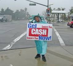 sign twirler highland sign spinner attracts business rain or shine news