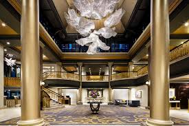the 250 000 crystal rose shaped chandelier floats above the lobby at the fairmont empress hotel