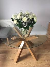 oak and glass round dining table next