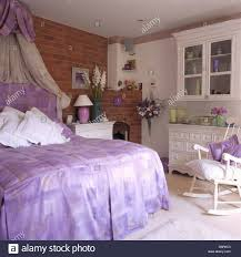 Mauve Bedroom Coronet With Cream Voile Drapes Above Bed With Mauve Headboard And