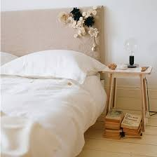 bedroom design uk. Neutral Bedroom With Double Bed, Wood Floorboards Bedside Table, Table Lamp And Floral Cluster Design Uk .
