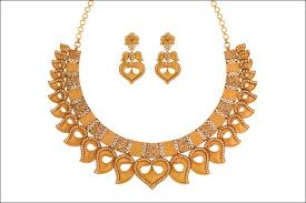 a gold and diamond necklace set