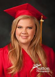 red cap and gown senior portrait blond
