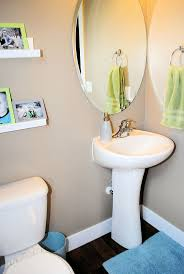 Small Half Bath / Powder Room Ideas - Picture Shelves/Colored Frames