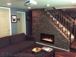 this is a clever idea that makes use of a space that typically goes ignored 11 faux layered stone fireplace surround with rustic wooden mantel