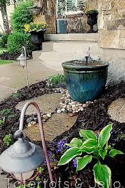 18 outdoor fountain ideas how to make a garden fountain for your backyard
