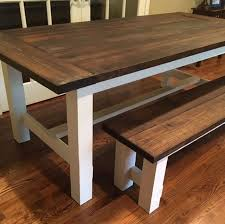 standard style farmhouse table stained in minwax jacobean with heirloom white on the base
