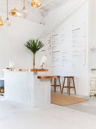 Loeffler Furniture Design Center Clean Cafe Design White Interior With Copper Accents In An