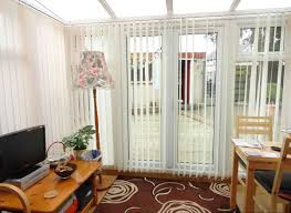 home office and study design in white room with skylight and red patterned area rug and