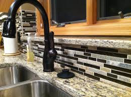 Pacific S Kitchen Faucets Delta Oil Rubbed Bronze Faucet Backsplash Is Glass And Stone Mc