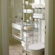 Small bathrooms can easily look cluttered, so having good storage is extra  critical. Stay organized by adding mounted wall shelves and tall, ...