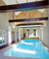 indoor swimming pool lighting. Brilliant Indoor Swimming WIth Exposing Beams Pool Lighting