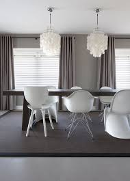 Above image: soft grey and taupe contemporary dining room by Interior  design company Remy Meijers from the Netherlands, with a mixture of iconic  chairs such ...