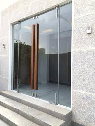 frameless glass entry doors residential vestibule doors glass with natural wood handles home foyer decor frameless glass entry