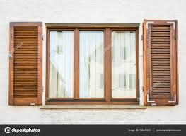 european windows wooden shutters old house texture outdoors exte stock photo