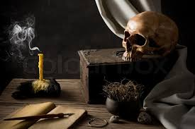 still life photography human skull with old wooden box old book and smoke of extinguished candle stock photo colourbox