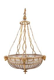 lot 268 an empire style gilded brass framed ceiling light the frame with rams heads bellflower swags and wire supports with opaque glass bowl